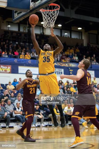 Kent State Golden Flashes F Jimmy Hall scores with a layup as Central Michigan Chippewas F Cecil Williams and Central Michigan Chippewas F David...