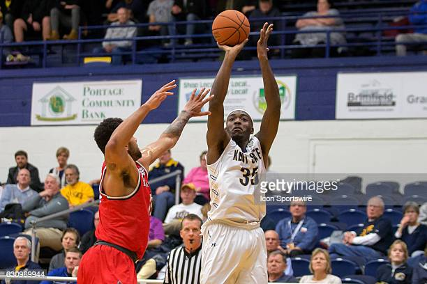 Kent State Golden Flashes F Jimmy Hall shoots as Ball State Cardinals F Franko House defends during the first half of the NCAA Men's Basketball game...