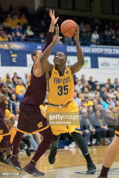 Kent State Golden Flashes F Jimmy Hall shoots as Central Michigan Chippewas F DaRohn Scott defends during the second half of the MAC men's basketball...