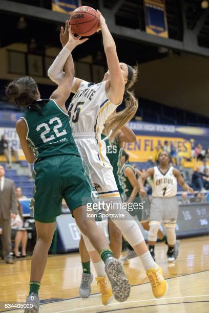 Kent State Golden Flashes F Jordan Korinek is fouled by Eastern Michigan Eagles G Sheyna Deans during the second quarter of the women's college...
