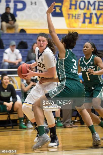 Kent State Golden Flashes F McKenna Stephens is defended by Eastern Michigan Eagles F Tori Easley during the first quarter of the women's college...