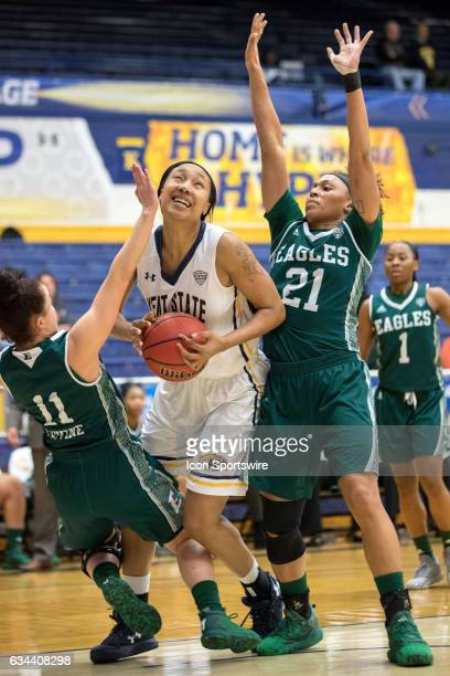 Kent State Golden Flashes F Merissa BarberSmith is defended by Eastern Michigan Eagles G Esabelle Levine and Eastern Michigan Eagles G Phillis Webb...