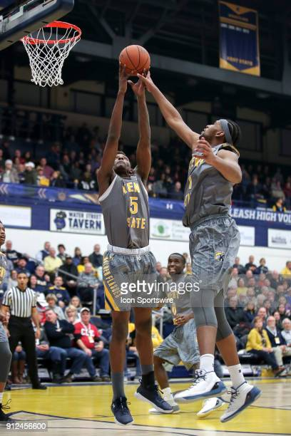Kent State Golden Flashes forward Danny Pippen and Kent State Golden Flashes center Adonis De La Rosa reach for a rebound during the first half of...