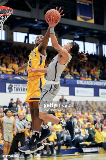 Kent State Golden Flashes forward Danny Pippen defends the shot of Akron Zips guard Virshon Cotton during the first half of the men's college...