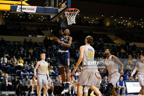 Kent State Golden Flashes forward Danny Pippen goes in for a layup during a regular season basketball game between the Kent State Golden Flashes and...