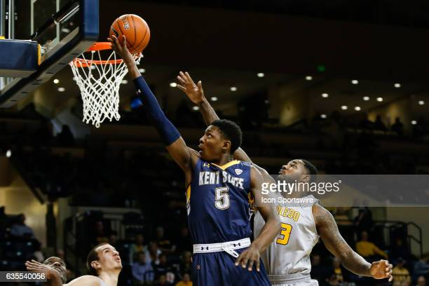 Kent State Golden Flashes forward Danny Pippen goes in for a layup against Toledo Rockets forward Steve Taylor Jr during a regular season basketball...