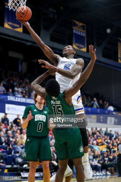 Kent State Golden Flashes forward Danny Pippen is foueld as he shoots by Ohio Bobcats guard Lunden McDay during the second half of the men's college...