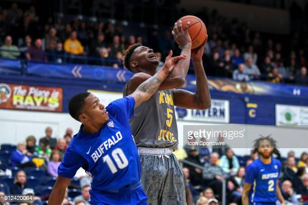 Kent State Golden Flashes forward Danny Pippen is fouled in the act of shooting by Buffalo Bulls guard Wes Clark during the second half of the men's...