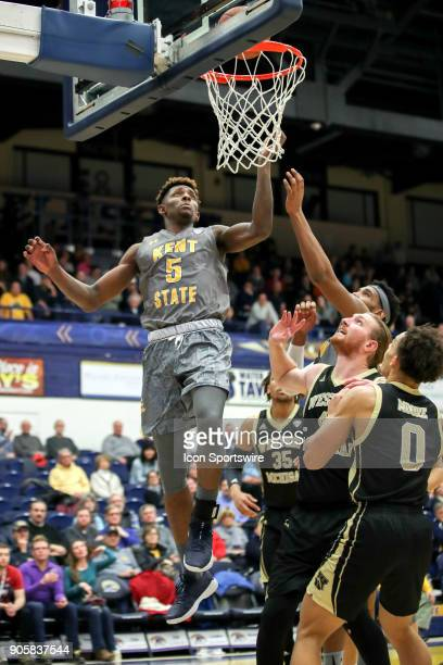 Kent State Golden Flashes forward Danny Pippen scores during the second half of the men's college basketball game between the Western Michigan...