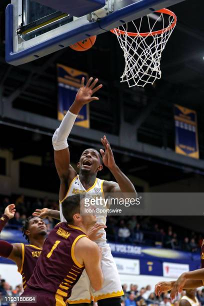 Kent State Golden Flashes forward Danny Pippen shoots and scores after being fouled by Central Michigan Chippewas guard Corey Redman during the...