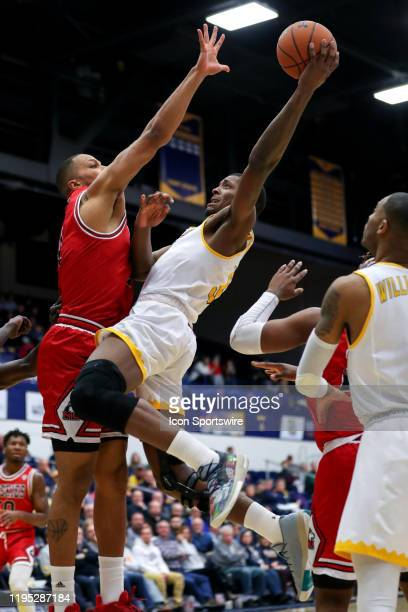 Kent State Golden Flashes forward Danny Pippen shoots as Northern Illinois Huskies forward Lacey James defends during the second half of the men's...