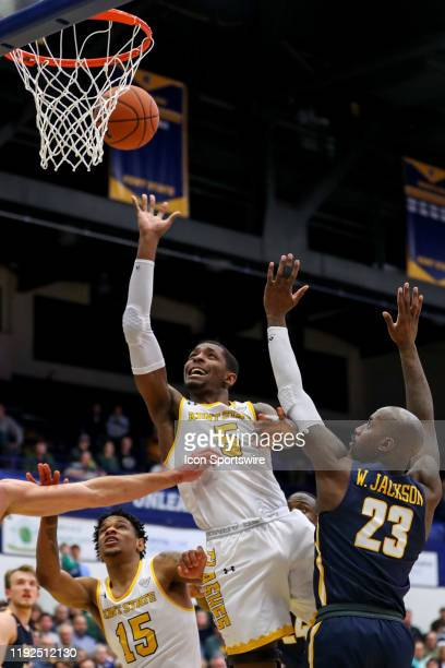 Kent State Golden Flashes forward Danny Pippen shoots as Toledo Rockets forward Willie Jackson defends during the second half of the men's college...
