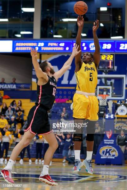Kent State Golden Flashes forward Danny Pippen shoots over Ball State Cardinals forward Brachen Hazen during the second half of the men's college...