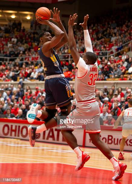 Kent State Golden Flashes forward Danny Pippen shoots the ball over Ohio State Buckeyes forward EJ Liddell during the game between the Ohio State...