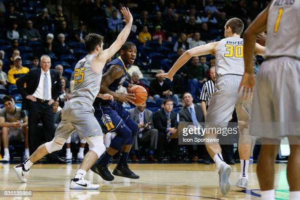 Kent State Golden Flashes forward Jimmy Hall drives to the basket against Toledo Rockets guard Jordan Lauf during a regular season basketball game...