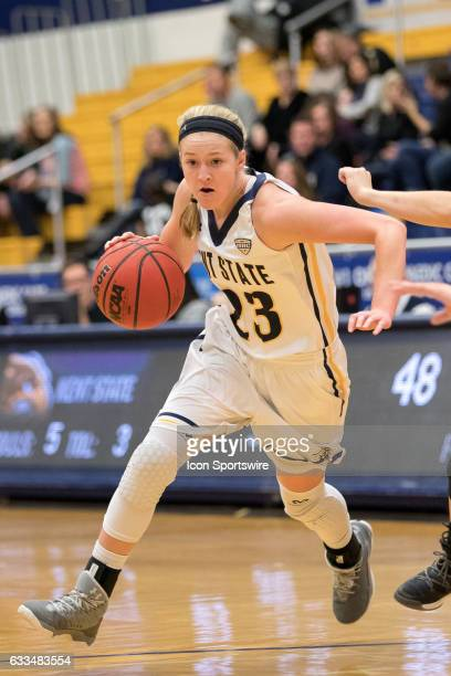 Kent State Golden Flashes G Ali Poole drives to the basket during the third quarter of the Women's college basketball game between the Miami Redhawks...