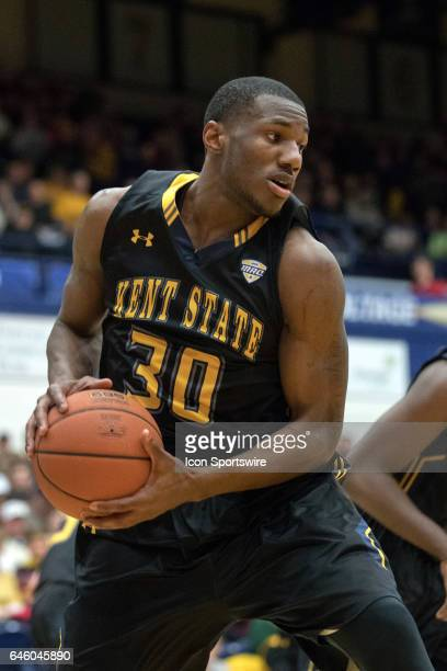 Kent State Golden Flashes G Deon Edwin comes down with a rebound during the first half of the men's college basketball game between the Ohio Bobcats...