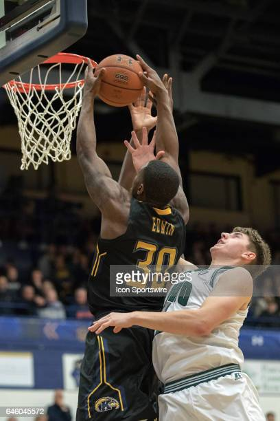 Kent State Golden Flashes G Deon Edwin grabs a rebound against Ohio Bobcats F Jason Carter during the second half of the men's college basketball...