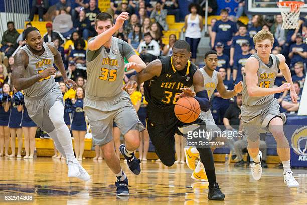 Kent State Golden Flashes G Deon Edwin runs a fast break as Toledo Rockets F Nate Navigato defends during the second half of the NCAA Men's...