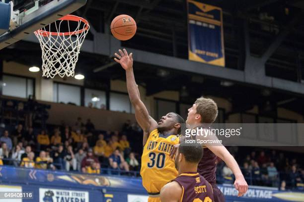 Kent State Golden Flashes G Deon Edwin shoots as Central Michigan Chippewas F David DiLeo and Central Michigan Chippewas F DaRohn Scott defend during...