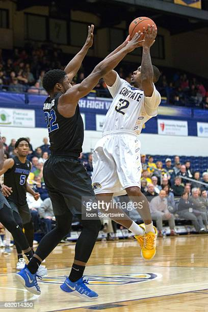 Kent State Golden Flashes G Desmond Ridenour goes up for a shot as Buffalo Bulls G Dontay Caruthers defends during the second half of the NCAA Men's...