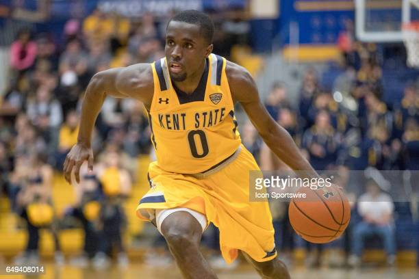 Kent State Golden Flashes G Jalen Avery drives to the basket during the second half of the MAC men's basketball tournament game between the Central...