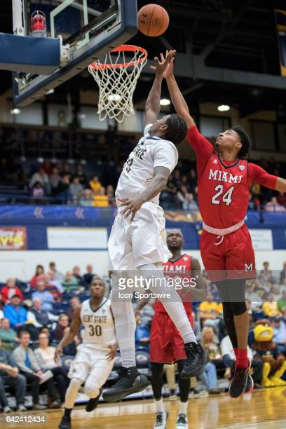 Kent State Golden Flashes G Jaylin Walker puts up a shot as Miami RedHawks G Michael Weathers defends during the second half of the men's college...