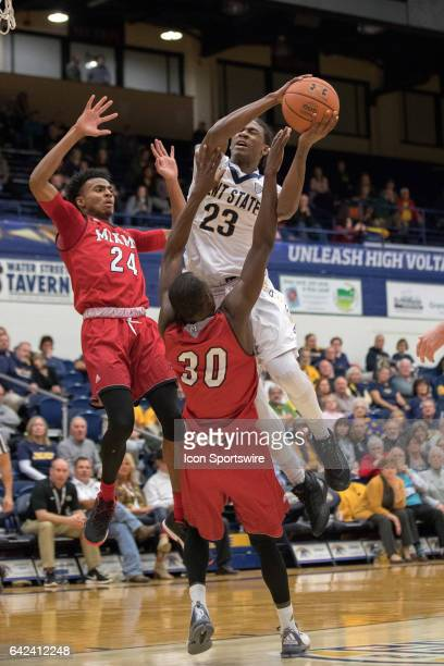 Kent State Golden Flashes G Jaylin Walker shoots after being fouled by Miami RedHawks G Abdoulaye Harouna as Miami RedHawks G Michael Weathers also...