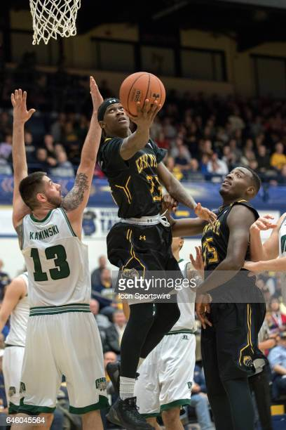 Kent State Golden Flashes G Jaylin Walker shoots as Ohio Bobcats G Rodney Culver defends during the second half of the men's college basketball game...