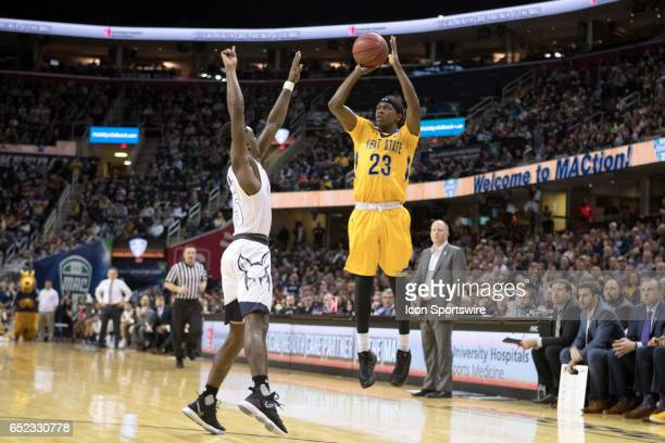 Kent State Golden Flashes G Jaylin Walker shoots over Akron Zips G Antino Jackson during the second half of the MAC mens basketball tournament...