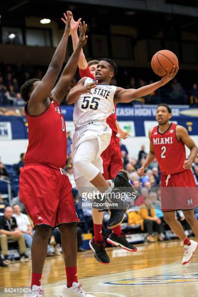 Kent State Golden Flashes G Kevin Zabo dreives to the basket by Miami RedHawks C Darius Harper during the second half of the men's college basketball...