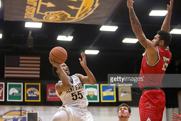 Kent State Golden Flashes G Kevin Zabo goes up for a shot as Ball State Cardinals F Franko House defends during the first half of the NCAA Men's...