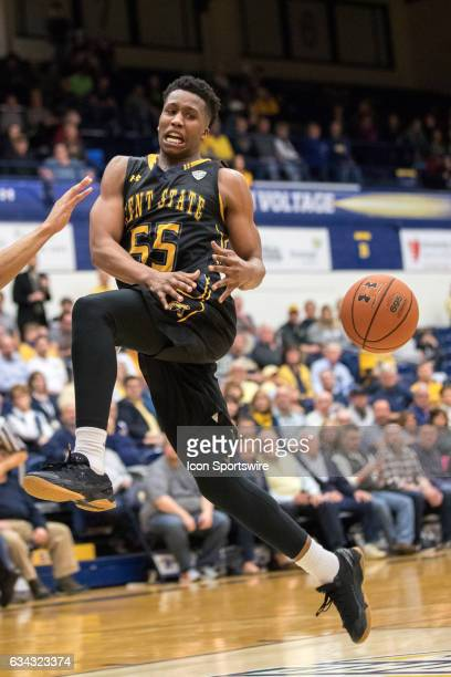 Kent State Golden Flashes G Kevin Zabo has the basketball knocked away by a defender as he drives to the basket during overtime of the men's college...