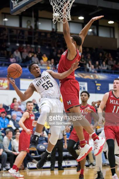 Kent State Golden Flashes G Kevin Zabo is defended by Miami RedHawks F Rod Mills Jr defends during the second half of the men's college basketball...