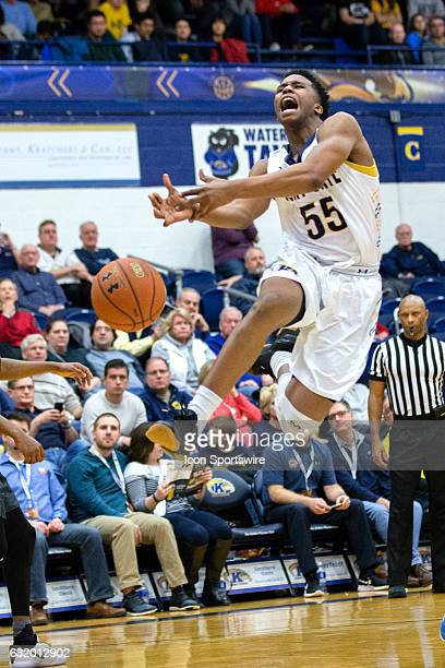 Kent State Golden Flashes G Kevin Zabo looses the basketball as he drives to the hoop during the second half of the NCAA Men's Basketball game...