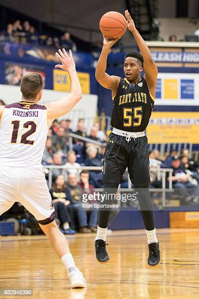 Kent State Golden Flashes G Kevin Zabo shoots over Central Michigan Chippewas G Josh Kozinski during the second half of the college men's basketball...