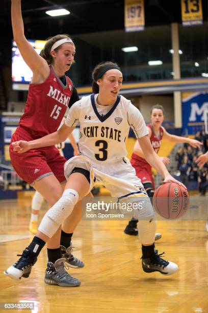 Kent State Golden Flashes G Larissa Lurken is defended by Miami Redhawks G Kayla Brown during the third quarter of the Women's college basketball...
