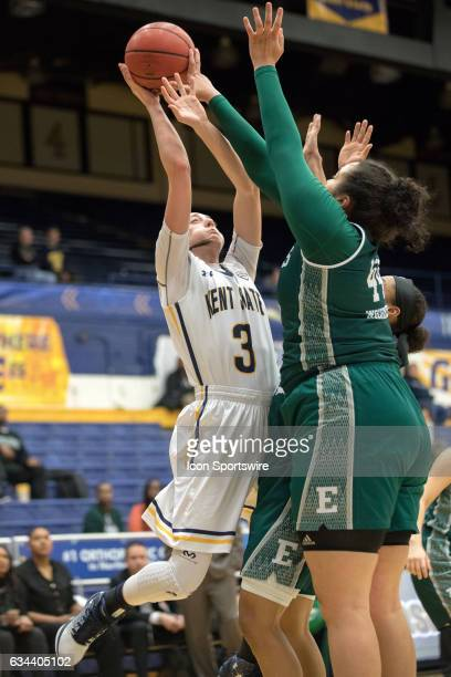 Kent State Golden Flashes G Larissa Lurken is fouled by Eastern Michigan Eagles F Ashley Nickens during the second quarter of the women's college...