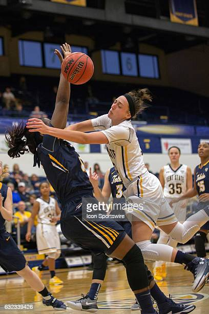 Kent State Golden Flashes G Larissa Lurken is fouled by Toledo Rockets F Janice Monakana during the third quarter of the NCAA Women's Basketball game...