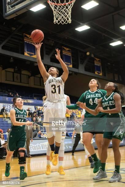 Kent State Golden Flashes G Megan Carter shoots as Eastern Michigan Eagles G Esabelle Levine Eastern Michigan Eagles F Ashley Nickens and Eastern...