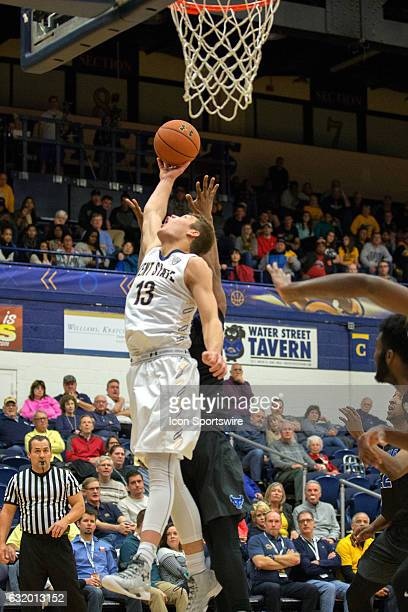Kent State Golden Flashes G Mitch Peterson grabs a rebound during the second half of the NCAA Men's Basketball game between the Buffalo Bulls and...