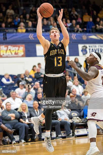 Kent State Golden Flashes G Mitch Peterson shoots as Central Michigan Chippewas G Braylon Rayson defends during the second half of the college men's...