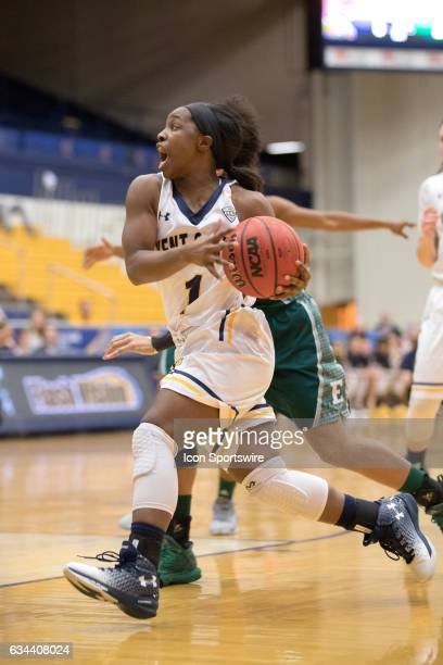 Kent State Golden Flashes G Naddiyah Cross drives to the basket during the first quarter of the women's college basketball game between the Eastern...