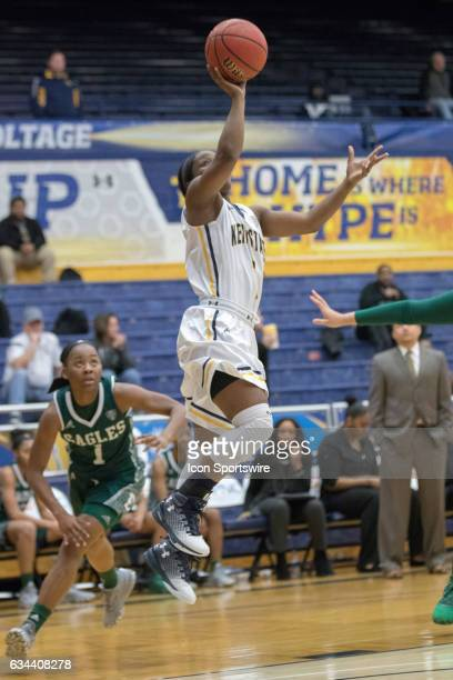 Kent State Golden Flashes G Naddiyah Cross shoots during the first quarter of the women's college basketball game between the Eastern Michigan Eagles...