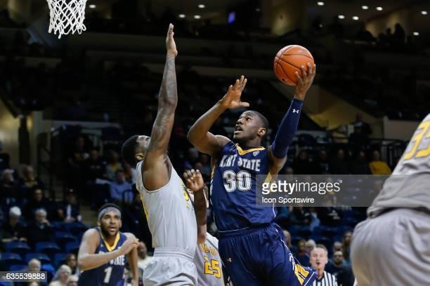 Kent State Golden Flashes guard Deon Edwin shoots over Toledo Rockets forward Steve Taylor Jr during a regular season basketball game between the...
