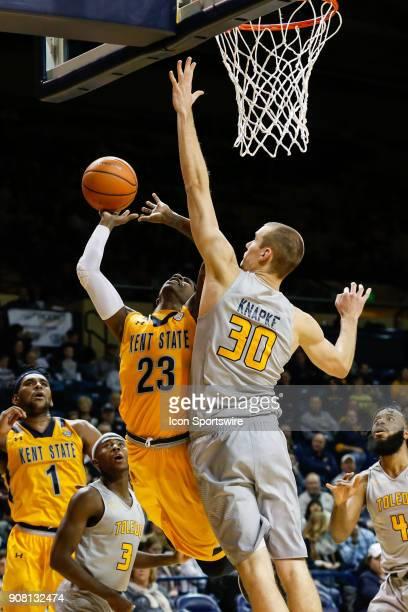 Kent State Golden Flashes guard Jaylin Walker goes in for a layup against Toledo Rockets forward Luke Knapke during the second half of a regular...