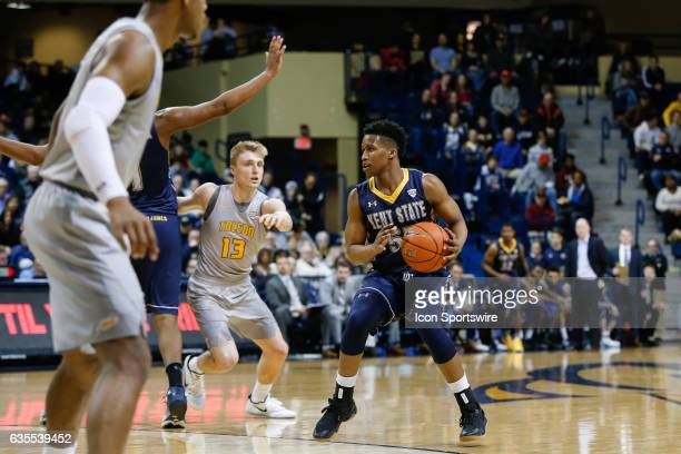 Kent State Golden Flashes guard Kevin Zabo brings the ball upcourt during a regular season basketball game between the Kent State Golden Flashes and...