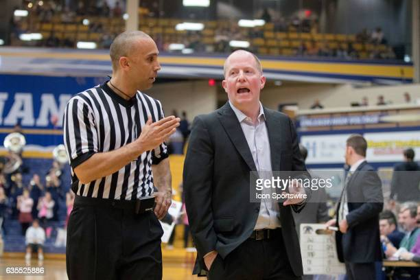 Kent State Golden Flashes head coach Rob Senderoff discusses a call with an official during the second half of the men's college basketball game...