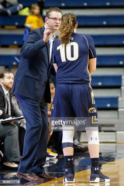 Kent State Golden Flashes head coach Todd Starkey talks to Kent State Golden Flashes forward McKenna Stephens during the second half of a regular...