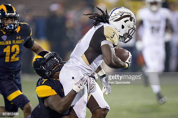 Kent State Golden Flashes LB Elcee Refuge makes a tackle on Western Michigan Broncos RB Fabian Johnson during the fourth quarter of the NCAA Football...